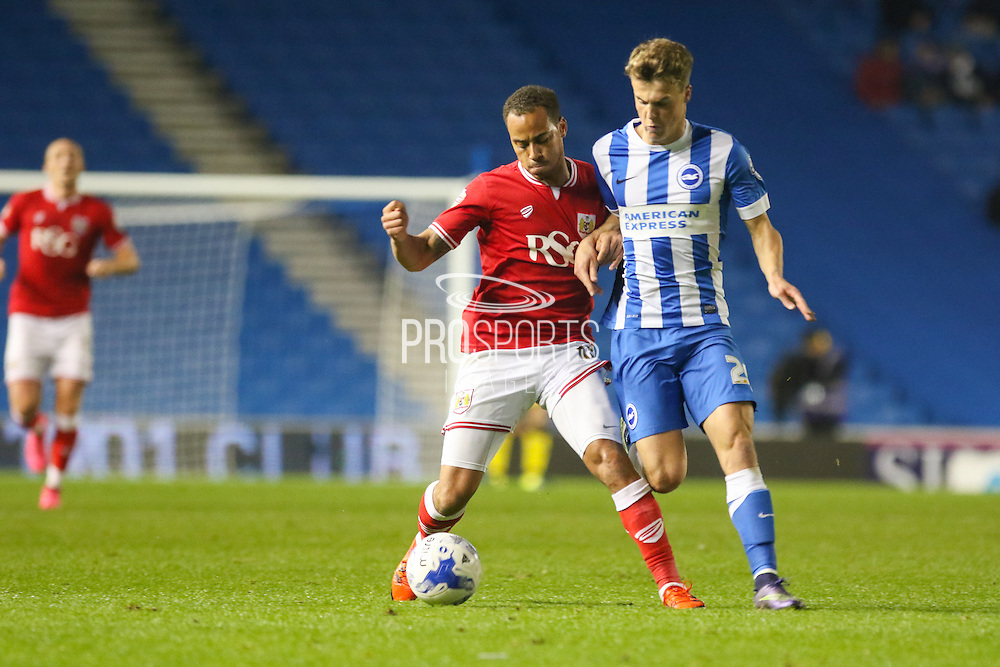 Bristol City midfielder Elliott Bennett (13) battles with Brighton striker, Solomon March (20) during the Sky Bet Championship match between Brighton and Hove Albion and Bristol City at the American Express Community Stadium, Brighton and Hove, England on 20 October 2015. Photo by Phil Duncan.