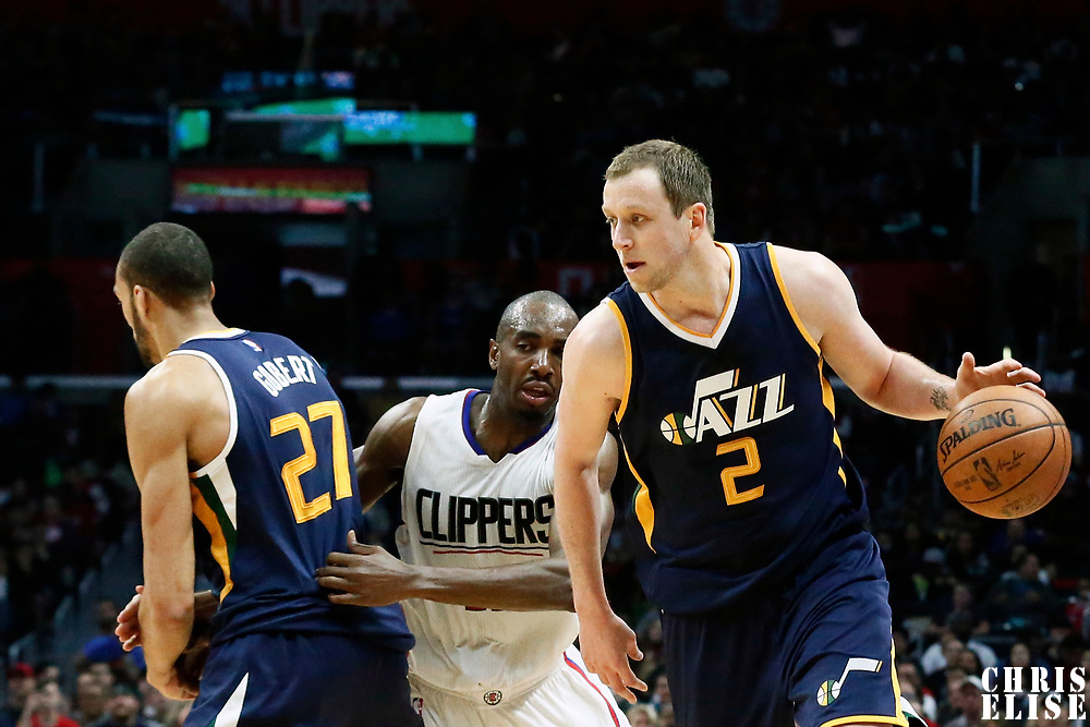 25 March 2016: Utah Jazz forward Joe Ingles (2) drives past LA Clippers forward Luc Mbah a Moute (12) on a screen set by Utah Jazz center Rudy Gobert (27) during the Los Angeles Clippers 108-95 victory over the Utah Jazz, at the Staples Center, Los Angeles, California, USA.