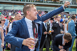 © Licensed to London News Pictures. 18/06/2014. Ascot, UK. A man cheers on a horse in Jersey Stakes (Group 3). Day two at Royal Ascot 18th June 2014. Royal Ascot has established itself as a national institution and the centrepiece of the British social calendar as well as being a stage for the best racehorses in the world. Photo credit : Stephen Simpson/LNP