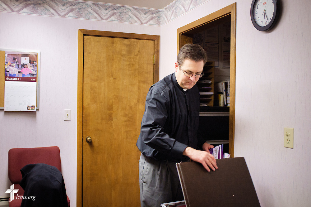 The Rev. Mark Nierman, pastor of Mount Olive Lutheran Church, loads up his case with home visitation supplies on Wednesday, March 2, 2016, in Loveland, Colo. LCMS Communications/Erik M. Lunsford