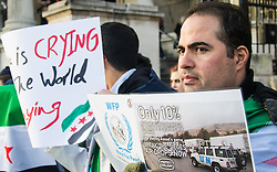 Trafalgar Square, London, January 16th 2016. Dozens of Syrians protest demanding food drops to besieged rebel-held towns. They claim that only 10% of the UN's requests to deliver food to towns such as Madaya are granted by the Assad regime, which is enjoying the support of Russian bombers in fighting rebels. ///FOR LICENCING CONTACT: paul@pauldaveycreative.co.uk TEL:+44 (0) 7966 016 296 or +44 (0) 20 8969 6875. ©2015 Paul R Davey. All rights reserved.