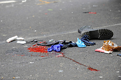 © Licensed to London News Pictures. 03/05/2017. London, UK. Blood stains and personal possessions lie on the tarmac.  Police and emergency services attend the scene of a reported traffic accident between a lorry and a motorbike which has taken place in Northumberland Avenue near Trafalgar Square.  The injured motorcyclist has been taken to hospital via an air ambulance and the road is currently cordoned off.   Photo credit : Stephen Chung/LNP