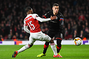 Rennes Hatem Ben Arfa (18) and Arsenal Midfielder Ainsley Maitland-Niles (15) battle for the ball during the Europa League round of 16, leg 2 of 2 match between Arsenal and Rennes at the Emirates Stadium, London, England on 14 March 2019.