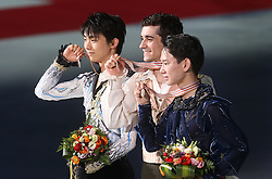 (L-R) Silver medalist Yuzuru Hanyu of Japan, gold medalist Javier Fernandez of Spain and bronze medalist Denis Ten of Kazakhstan hold their medals during a victory ceremony for the Men at the ISU World Figure Skating Championships at Shanghai Oriental Sports Center in Shanghai, China, 28 March 2015.