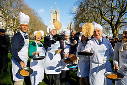 © Licensed to London News Pictures. 28/02/2017. London, UK. MP's team practise their pancake flips before racing against Lords and members of media at of the annual Rehab Parliamentary Pancake Race outside the Parliament on Shrove Tuesday, 28 February 2017. Photo credit: Tolga Akmen/LNP