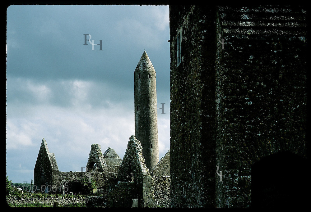 Kilmacduagh round tower (112') looms behind church bldgs where St Colman founded monastery;Gort Ireland