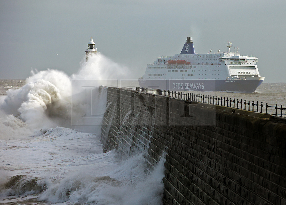 Licensed to London News Pictures. 01/02/2015. DFDS Amsterdam to Newcastle ferry King Seaways passing Tynemouth pier as she arrives in the river Tyne over 4 hours late due to heavy seas and strong winds. Photo credit: Adrian Don/LNP