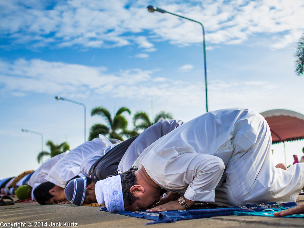 28 JULY 2014 - KHLONG HAE, SONGKHLA, THAILAND: Men pray during Eid at Songkhla Central Mosque in Songkhla province of Thailand. Eid al-Fitr is also called Feast of Breaking the Fast, the Sugar Feast, Bayram (Bajram), the Sweet Festival and the Lesser Eid, is an important Muslim holiday that marks the end of Ramadan, the Islamic holy month of fasting.   PHOTO BY JACK KURTZ