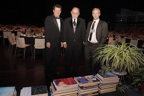 Award winners (from left).Nicholas Kristof, Richard Bausch and E. Benjamin Skinner in front of the finalists they beat out before the 2009 Dayton Literary Peace Prize dinner and awards presentation at the Schuster Center in downtown Dayton, Sunday November 08, 2009.