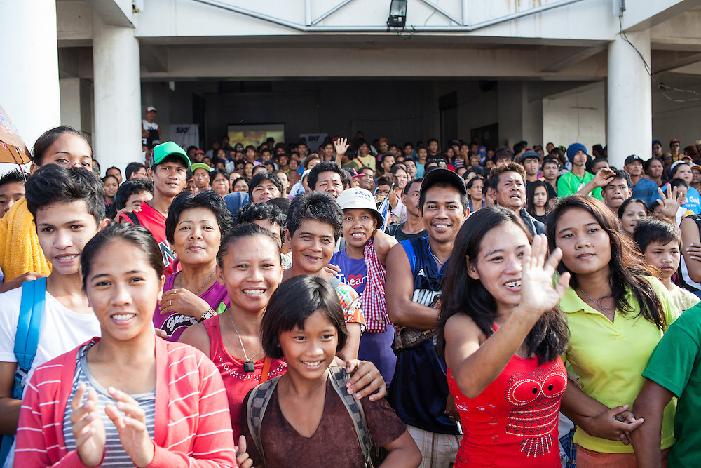 Crowd gathers at Tacloban City Astrodome Convention Center awaiting the arrival of Manny Pacquiao.<br /> <br /> Manny Pacquaio visits victims of Typhoon Yolanda in Tacloban City.  Leyte, Philippines  December 2, 2013