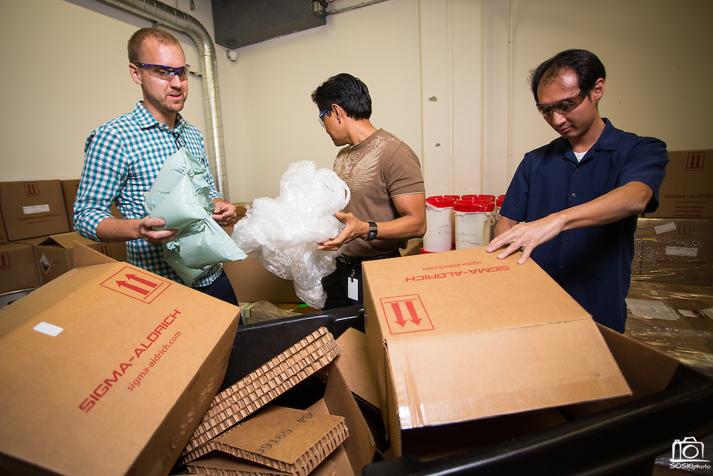 Nanosys employees recycle cardboard boxes and clean glass bottles at Nanosys in Milpitas, California, on October 16, 2014. (Stan Olszewski/SOSKIphoto)