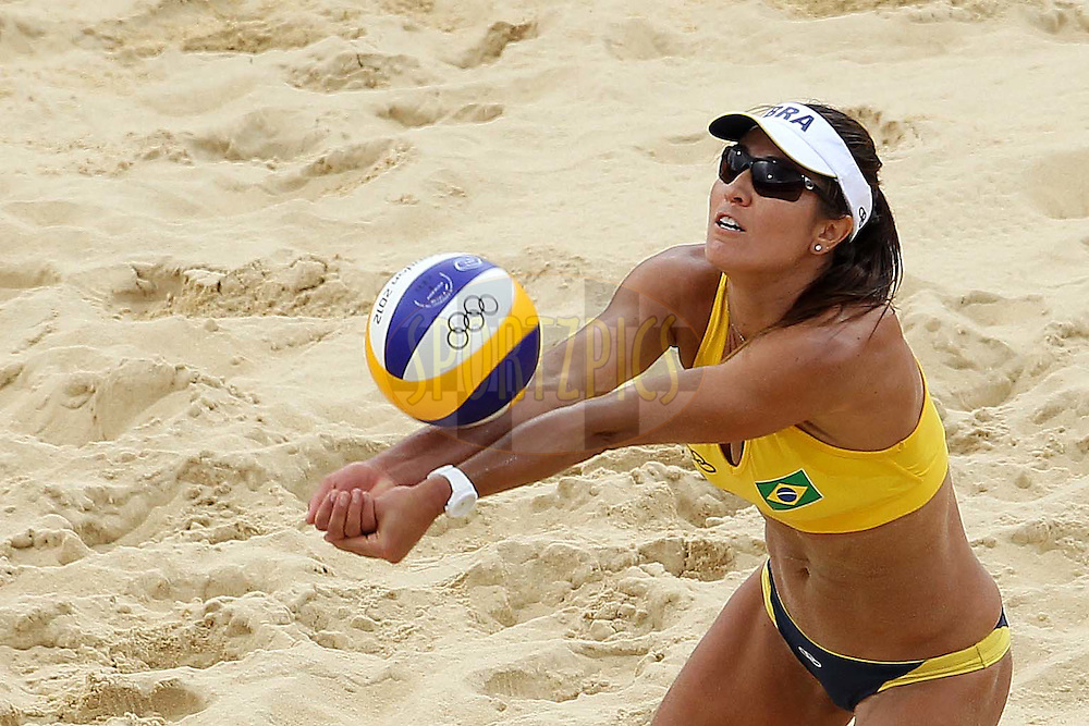 Maria Antonelli of Brazilduring the Women's Beach Volleyball Preliminary Phase Pool E match between Brazil and Germany held at the Horse Guards Parade stadium in London as part of the London 2012 Olympics on the 31st July 2012.Photo by Ron Gaunt/SPORTZPICS