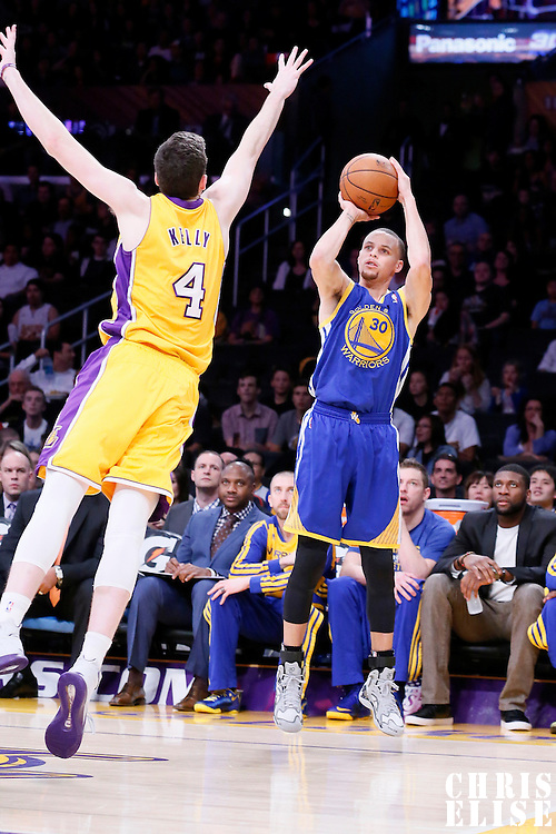 11 April 2014: Golden State Warriors guard Stephen Curry (30) takes a jump shot over Los Angeles Lakers forward Ryan Kelly (4) during the Golden State Warriors 112-95 victory over the Los Angeles Lakers at the Staples Center, Los Angeles, California, USA.