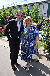 PIERS MORGAN and his mother at the 2011 RHS Chelsea Flower Show VIP & Press Day at the Royal Hospital Chelsea, London, on 23rd May 2011.