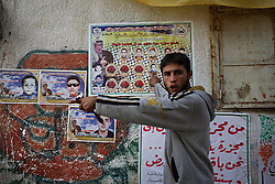 A Palestinian man is seen venting anger over the deaths of his relatives caused by Israeli artillery fire, Beit Hanoun, Gaza Strip, Palestinian Territories, Nov. 13, 2006. Israel blames the deaths on a targeting error and expresses regret. According to Human Rights Watch, since September 2005, Israel has fired about 15,000 rounds at Gaza while Palestinian militants have fired around 1,700 back.