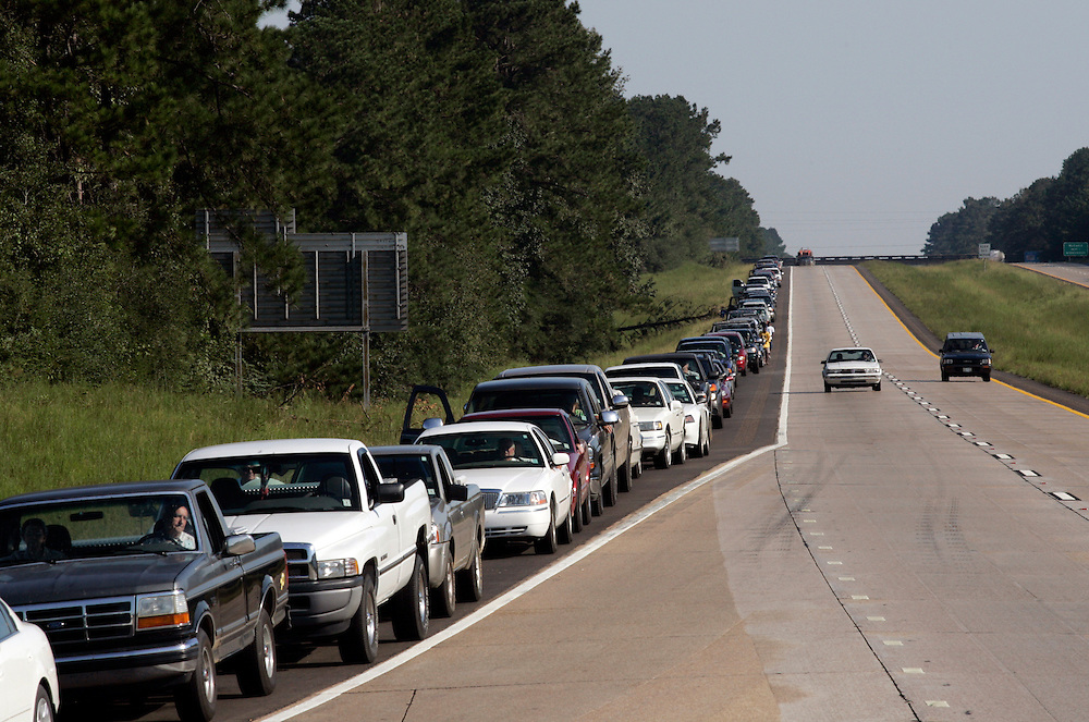 JACKSON, MS - September 4, 2005:  Drivers line Interstate 55 near Jackson Mississippi in hopes of getting gas at one of the few gas stations operating in the area on Sept, 4, 2005 following the destruction caused by Hurricane Katrina. (Photo by Todd Bigelow/Aurora)