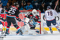 KELOWNA, CANADA - OCTOBER 21: Michael Herringer #30 of the Kelowna Rockets makes a save against the Tri-City Americans on October 21, 2016 at Prospera Place in Kelowna, British Columbia, Canada.  (Photo by Marissa Baecker/Shoot the Breeze)  *** Local Caption ***