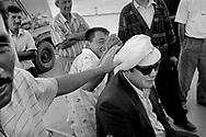 4/5: Fishermen joking in the town of Aralsk  / Aralsk region, Kazakhstan