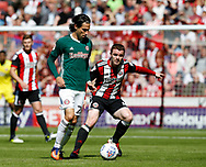 Jota of Brentford and John Fleck of Sheffield Utd during the English Championship League match at Bramall Lane Stadium, Sheffield. Picture date: August 5th 2017. Pic credit should read: Simon Bellis/Sportimage