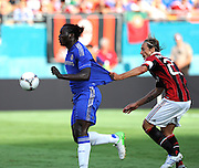 28 July 2012: Chelsea FC Romelu Lukaku (18) controls the ball as AC Milan Massimo Ambrosini (23) grabs his shirt during the World Football Challenge as A.C. Milan defeated Chelsea FC 1-0 at Sun Life Stadium in Miami, FL.