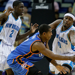 Oct 10, 2009; New Orleans, LA, USA;  Oklahoma City Thunder guard Kevin Ollie (7) is defended by New Orleans Hornets rookie guard Darren Collison (2) and forward James Posey (41) during a preseason game at the New Orleans Arena. The Hornets defeated the Thunder 88-79. Mandatory Credit: Derick E. Hingle-US PRESSWIRE