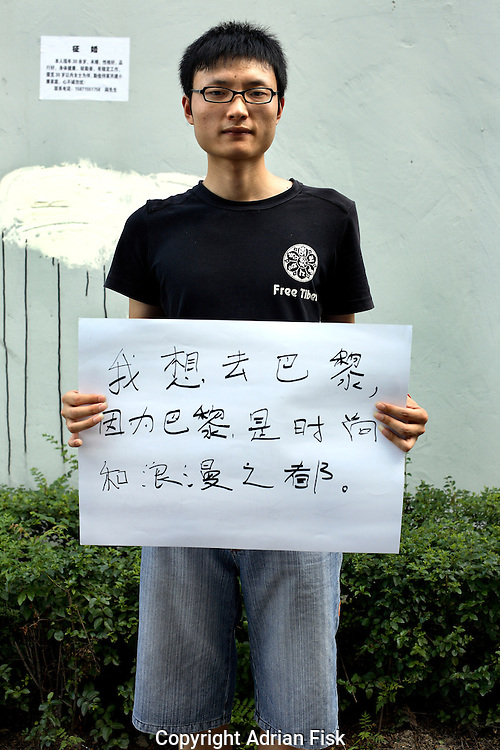 Fu Wie Dong - 22 Yrs.<br /> Was an insurance agent now unemployed.<br /> Hubei Province.<br /> <br /> 'I want to go to Paris, because Paris is the capitial of Romance and fashion'.
