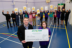 Branston Ltd have presented a cheque to KIDS Lincolnshire for &pound;19,425.60.  Pictured is Branston Ltd's general manager John Griffin, left, presenting the cheque to KIDS Lincolnshire play practitioner Sarah Ford<br /> <br /> Picture: Chris Vaughan Photography for Branston Ltd<br /> Date: February 15, 2018