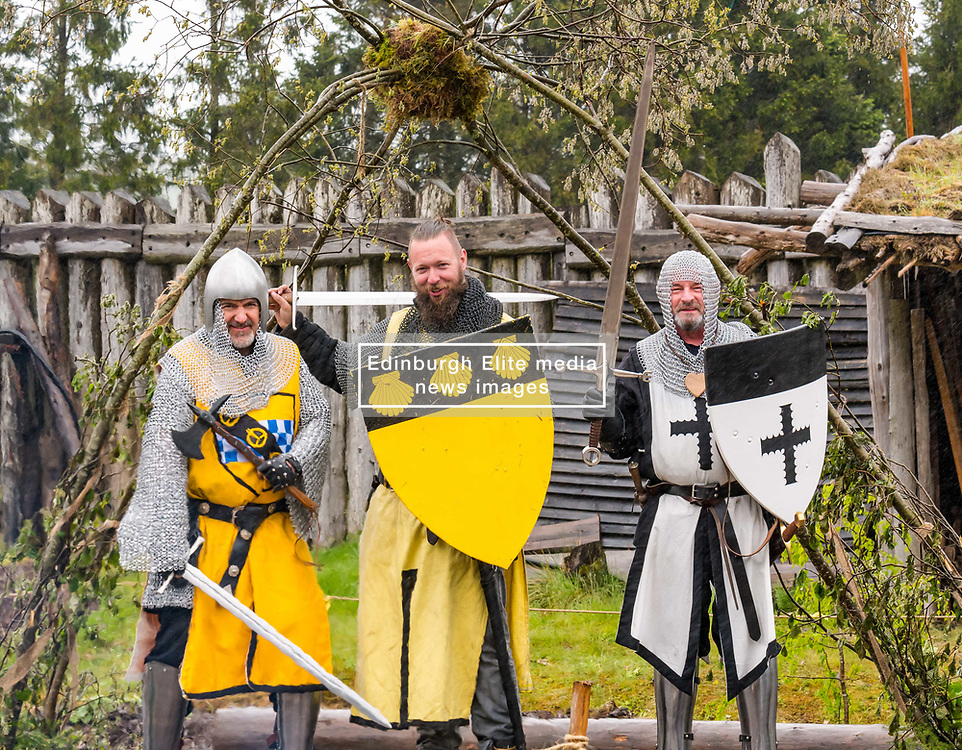 Pictured: Knights from the Society of John De Graeme at Duncarron Medieval Village Opening. Carron Valley Forest, Lanarkshire, 18 May 2019. In authentic Scottish weather, The Clanranald Trust opens a full-scale replica of an early Medieval Fortified Village typical of a Scottish Clan Chief's residence. The open air museum includes traditional buildings such as round houses, a great hall, and tower. <br /> Sally Anderson | EdinburghElitemedia.co.uk