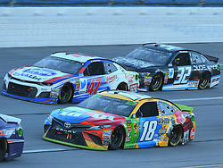 October 14, 2018 - Talladega, AL, U.S. - TALLADEGA, AL - OCTOBER 14: Kyle Busch, Joe Gibbs Racing, Toyota Camry M&M's (18) and A.J. Allmendinger, JTG Daugherty Racing, Chevrolet Camaro Kroger ClickList (47) race through the tri-oval during the 1000Bulbs.com 500 on October 14, 2018, at Talladega Superspeedway in Tallageda, AL.(Photo by Jeffrey Vest/Icon Sportswire) (Credit Image: © Jeffrey Vest/Icon SMI via ZUMA Press)