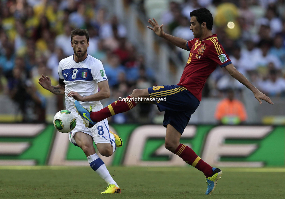 27.06.2013. Fortaleza, Brazil.  Spains  Sergio Busquets challenges for The Ball with Claudio Marchisio of Italy during The FIFA Confederations Cup Brazil 2013 Semi-finals Match  Spain won the semi-final on the penalty shoot out after full time and extra time produced no goals.