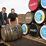 Diageo receives its accreditation as a Living Wage employer for it UK operations. Cabinet Secretary for Economy, Jobs &amp; Fair Work, Keith Brown MSP and apprentice Andrew Hunter. The barrel park, Alloa Cooperage, Diageo. 01 Sep 2017. <br /> Copyright photograph by Tina Norris. Not to be archived or reproduced without prior permission and payment. Contact Tina on 07775 593 830 info@tinanorris.co.uk www.tinanorris.co.uk http://tinanorris.photoshelter.com