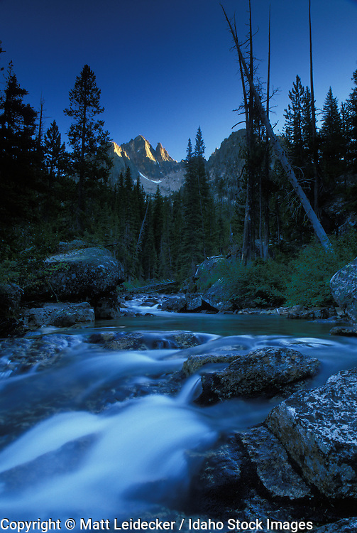 Idaho, Sawtooth Mountains.  Redfish Lake creek blured with Goats Perch in the back ground.