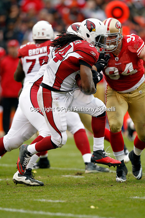 Arizona Cardinals running back Tim Hightower (34) leaps while running the ball during the NFL week 17 football game against the San Francisco 49ers on Sunday, January 2, 2011 in San Francisco, California. The 49ers won the game 38-7. (©Paul Anthony Spinelli)