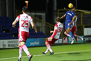 AFC Wimbledon striker Kweshi Appiah (9) with header on goal during the EFL Trophy group stage match between AFC Wimbledon and Stevenage at the Cherry Red Records Stadium, Kingston, England on 6 November 2018.