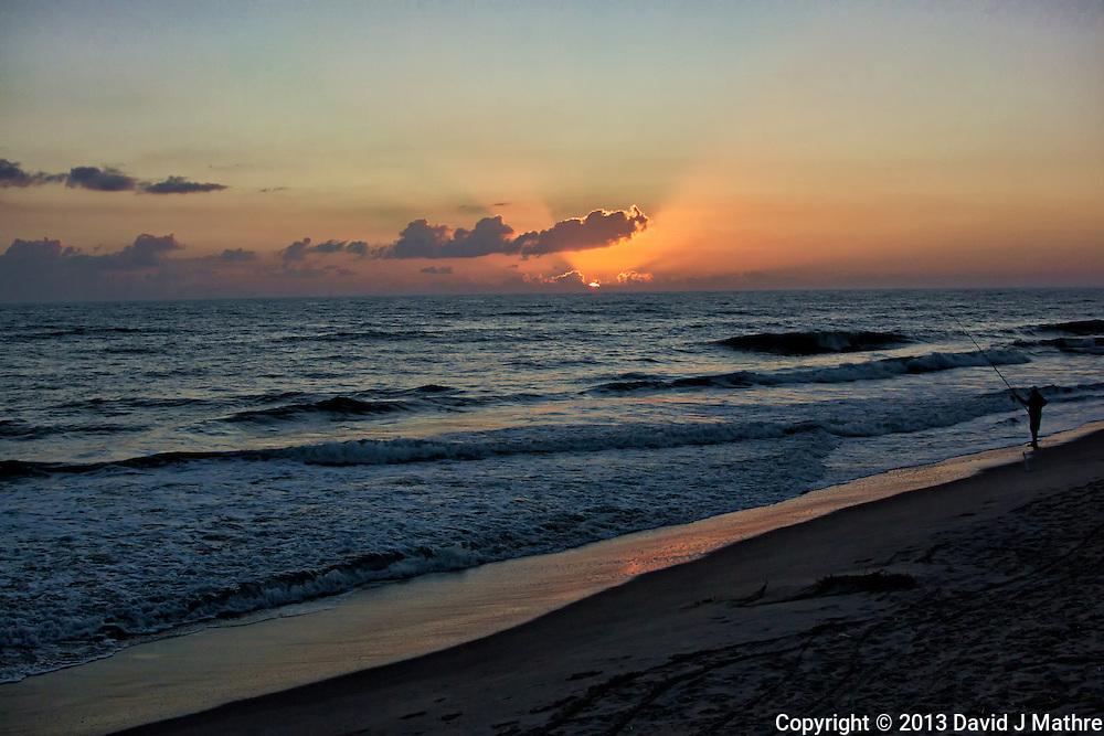 Lone Fisherman at Dawn.  Playalinda Beach, Canaveral National Seashore in Florida. Image taken with a Nikon 1 V2 camera and 18.5 mm f/1.8 lens (ISO 200, 18.5 mm, f/4, 1/1000).