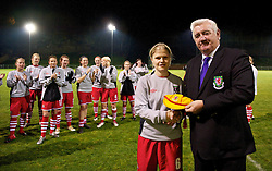 WREXHAM, WALES - Wednesday, November 24, 2010: Football Association of Wales President Phil Pritchard presents Michelle Green with an international cap before the International Friendly match against Bulgaria at the Rock. (Photo by David Rawcliffe/Propaganda)