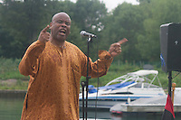 """Members of the 59th Street Harbor located at 5900 S. Lake Shore Drive hosted the African, Jamaican, and African-American Networking Showcase Thursday evening at the Harbor. The event showcased poetry and music about social and cultural issues.<br /> <br /> 3318, 3323 – Dr. Groove performs his poem titled, """"Take a Stand"""".<br /> <br /> Please 'Like' """"Spencer Bibbs Photography"""" on Facebook.<br /> <br /> All rights to this photo are owned by Spencer Bibbs of Spencer Bibbs Photography and may only be used in any way shape or form, whole or in part with written permission by the owner of the photo, Spencer Bibbs.<br /> <br /> For all of your photography needs, please contact Spencer Bibbs at 773-895-4744. I can also be reached in the following ways:<br /> <br /> Website – www.spbdigitalconcepts.photoshelter.com<br /> <br /> Text - Text """"Spencer Bibbs"""" to 72727<br /> <br /> Email – spencerbibbsphotography@yahoo.com"""