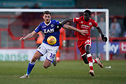 Harry Smith of Macclesfield Town is tackled by Panutche Camara of Crawley Town during the EFL Sky Bet League 2 match between Crawley Town and Macclesfield Town at The People's Pension Stadium, Crawley, England on 23 February 2019.
