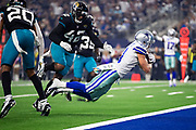 ARLINGTON, TX - OCTOBER 14:  Cole Beasley #11 of the Dallas Cowboys dives into the end zone for a touchdown in the first half of a game against the Jacksonville Jaguars at AT&T Stadium on October 14, 2018 in Arlington, Texas.  The Cowboys defeated the Jaguars 40-7.  (Photo by Wesley Hitt/Getty Images) *** Local Caption *** Cole Beasley