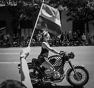 2013 June 30 - A woman rides a BMW motorcycle in the 2013 Gay Pride Parade on 4th Avenue, Seattle, WA. By Richard Walker