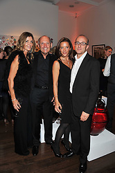 Left to right, CAROL WEATHERALL, RON DENNIS, SAMANTHA WICKENS and PAUL McKENNA at a reception to celebrate the publication of Candy and Candy: The Art of Design held at the Halcyon Gallery, 24 Bruton Street, London W1 on 26th October 2011.