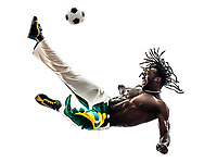 one Brazilian black man soccer player kicking football on white background