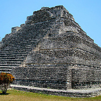 Temple Pyramid at Chacchoben Mayan Ruins near Costa Maya, Mexico<br /> The Mayan civilization began circa 2000 B.C. and extended through parts of Mexico, Belize, Guatemala and Honduras.  Seven significant ruin sites are in the state of Quintana Roo which includes resort cities like Cancun and Cozumel. This Maya ruin in the Yucatan is the stepped Temple Pyramid at Chacchoben near Costa Maya, Mexico.  It was built around 700 A.D. and discovered in 1972.