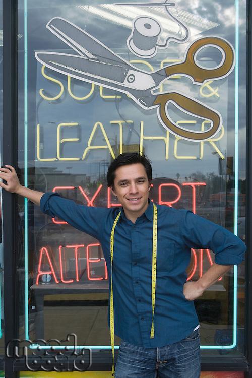 Man standing infront of laundrette shop window