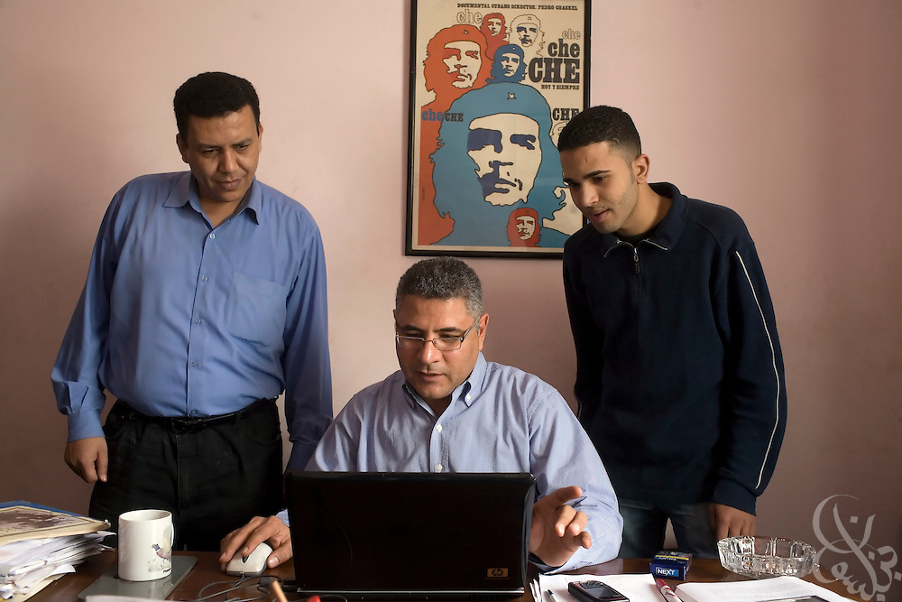 Gamal Eid, (c) executive director of the Arabic Network for Human Rights Information works with web publishers Kareem Abdel Rady (r)  and Abdo Abdel Aziz (l) March 08, 2009 at his office in downtown Cairo, Egypt. Eid  and the Arabic Network work closely advising and representing Egyptian bloggers legally, as many have faced increased political pressure and in some cases even detention, arrest or trial in cases where their writings angered the Egyptian government.