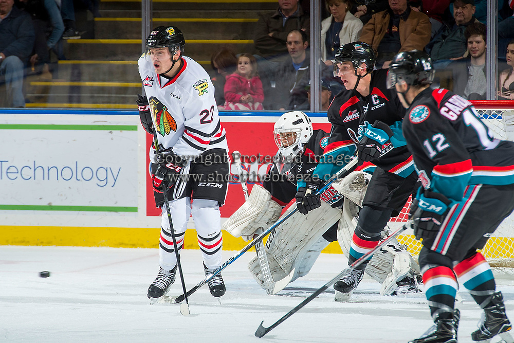 KELOWNA, CANADA - OCTOBER 20: James Porter #1 of the Kelowna Rockets defends the net behind Kieffer Bellows #22 of the Portland Winterhawks on October 20, 2017 at Prospera Place in Kelowna, British Columbia, Canada.  (Photo by Marissa Baecker/Shoot the Breeze)  *** Local Caption ***