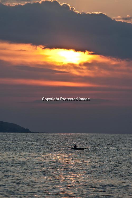INDONESIA, Flores Archipelago,  Palau island, sunset on the sea