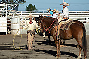 Juan Franco readies his rope at the family Charreria practice session in the Jalisco Highlands town of Capilla de Guadalupe, Mexico. The Franco family has dominated Mexican rodeo for 40-years and has won three national championships, five second places and five third places. Left to right are:
