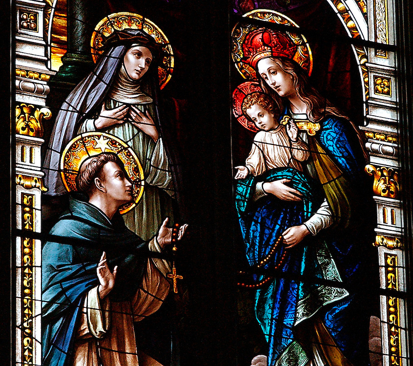 Stained glass window of St. Dominic and Our Lady of the Holy Rosary inside Bascilica of St. Josephat in Milwaukee. (Photo by Sam Lucero).