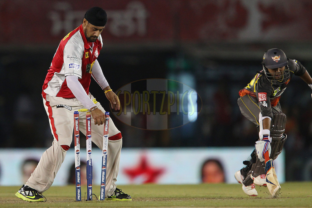 Harmeet Singh runs out Parthiv Patel during match 59 of of the Pepsi Indian Premier League between The Kings XI Punjab and the Sunrisers Hyderabad held at the PCA Stadium, Mohal, India  on the 11th May 2013..Photo by Ron Gaunt-IPL-SPORTZPICS ..Use of this image is subject to the terms and conditions as outlined by the BCCI. These terms can be found by following this link:..http://www.sportzpics.co.za/image/I0000SoRagM2cIEc